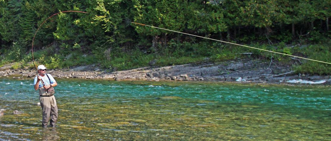 Fly fishing for Atlantic salmon in the Bonaventure River in the Gaspe Peninsula